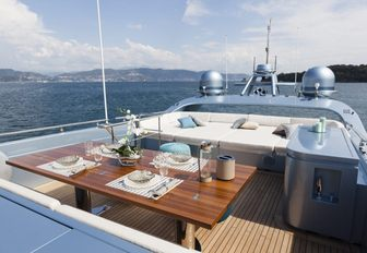 Table and sunpad area on deck of superyacht 55 FIFTYFIVE