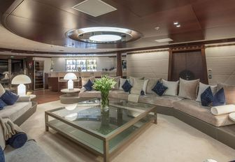 huge sofas in the main salon of charter yacht KATINA