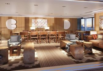 dining and seating areas in the wood-clad main salon aboard superyacht Planet Nine