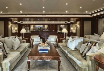 main salon styled with an American classic theme on board motor yacht Areti