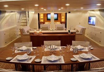dining table and comfortable lounge area in the sunken aft cockpit aboard luxury yacht FIDELIS