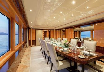 large, oblong dining table in the dining salon aboard luxury yacht Lucky Lady