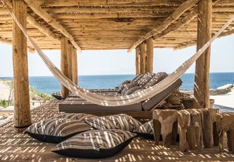 hammock and shaded loungers at Scorpios beach club in Mykonos, Greece