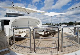 clam-shell seating area and sun pads on the foredeck of charter yacht Inception