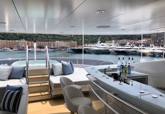 A bar and Jacuzzi on board a superyacht berthed in Port Hercules