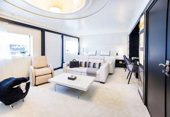 light and airy stateroom aboard luxury yacht SALUZI with seating area
