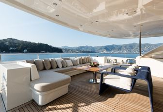 alfresco lounge on the main deck aft of motor yacht RESILIENCE