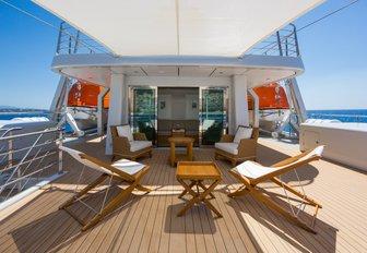 seating area on deck of superyacht yersin