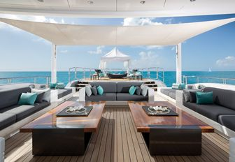 Bimini covers a chic outdoor lounge on the sundeck of charter yacht SIREN