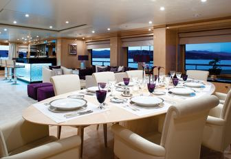 lime wood dining table in main salon of motor yacht 'Step One'