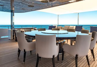 Chairs around dining table on superyacht RARITY