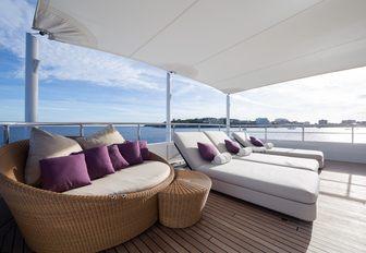 lounging option under retractable bimini aboard motor yacht GO