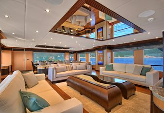 large sofas in the main salon of luxury yacht MEIRA