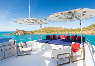Sun deck on superyacht AT LAST with seating and parasols