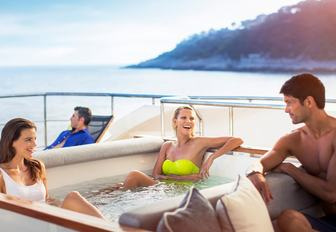 Charter guests relax in jacuzzi