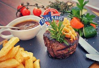 steak and chips presented on a slate board at Abu Dhabi's Stars 'N' Bars