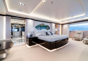 large bed in the light and airy master suite aboard luxury yacht O'PTASIA