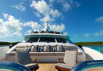 Portuguese bridge with seating and sun pads on board charter yacht Sweet Escape