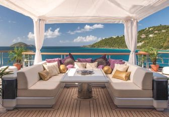 a cosy seating area for lunch or cocktails on board charter yacht SOLANDGE