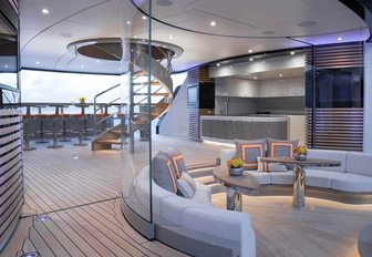 seating area with bar beyond on sundeck of luxury yacht KISMET