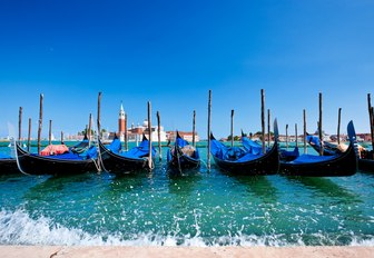 gondolas line up along the Grand Canal in Venice, Italy