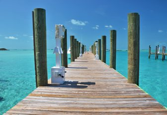 pier across the turquoise waters on Staniel Cay, Exumas, Bahamas