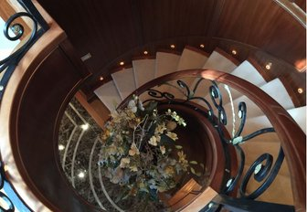 The spiral staircase featured in the interior of luxury yacht APOGEE