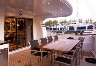 alfresco dining on the main deck aft of luxury yacht 'Mystic Tide'