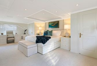 light and airy master suite on board luxury yacht PRAXIS