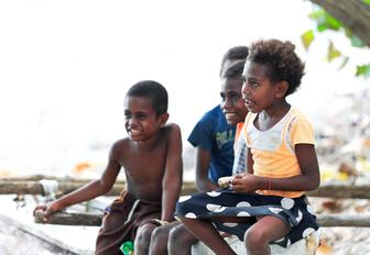 Four children of the Ni-Vanuatu people in Lamen Bay, Epi island, Vanuatu