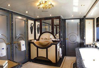en-suite bathroom in the master suite on board charter yacht DENIKI