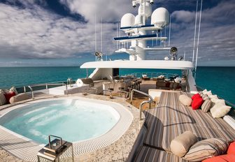 spa pool surrounded by sun pads on the sundeck of luxury yacht Remember When