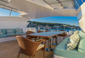 A long dining table situated on the sundeck of superyacht 'Africa I'
