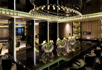 art deco-inspired dining area in the main salon of motor yacht SEALYON