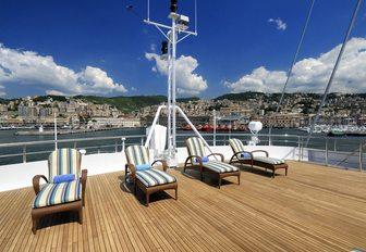 Sunloungers lined up on aft deck of megayacht Lauren L