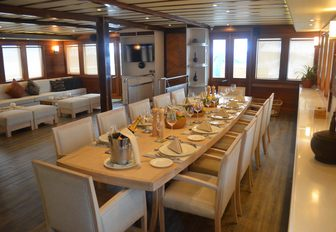 LAMIMA yacht interior dining in the main salon