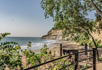 little beach framed by green trees on the isle of wight, exciting new english yacht charter destination