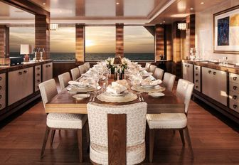 formal dining area set up for dinner on board charter yacht Lady E