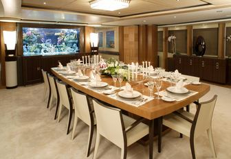 formal dining area in the main salon of luxury yacht WHEELS