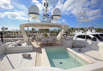 Jacuzzi and sun pads on bridge deck of superyacht SEALYON