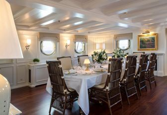 formal dining salon with period furniture and features on board charter yacht Haida 1929