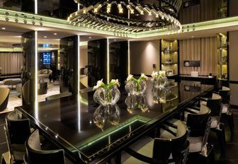 formal dining area in the art deco-themed main salon of luxury yacht SEALYON
