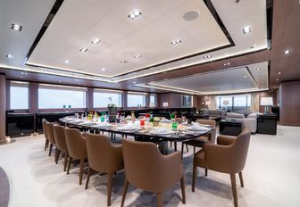 oval dining table in the main salon of motor yacht O'PTASIA