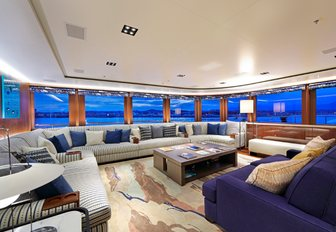 large sofas make up sociable seating area on board charter yacht Planet Nine