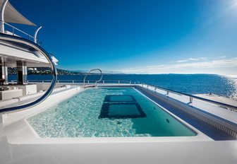 Pool on aft deck aboard superyacht Cloud 9