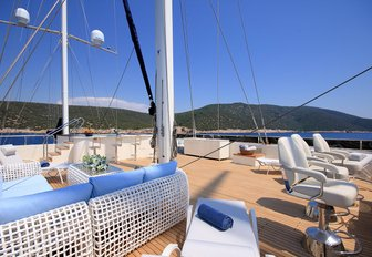 seating and Jacuzzi with swim-up bar on the flybridge of luxury yacht MEIRA