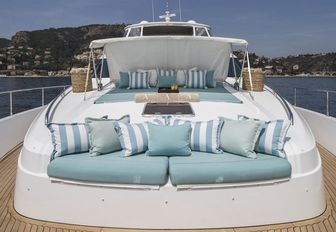 sun pads and seating area on the foredeck of motor yacht CRISTOBAL