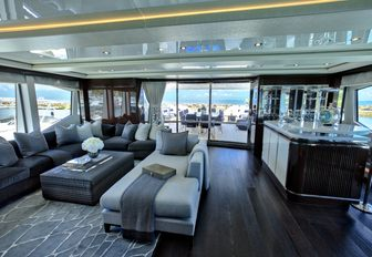 relaxed skylounge with seating and bar aboard luxury yacht Take 5
