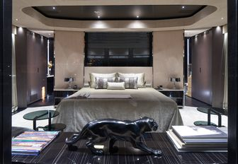 modern-styled master suite with large bed and panther statue on board superyacht SOLO