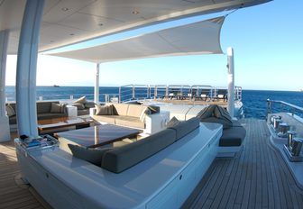 spacious aft deck area with seating aboard charter yacht SIREN